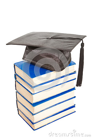 Books with black cap of bachelor isolated on white