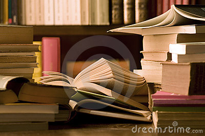 Books on desk and library