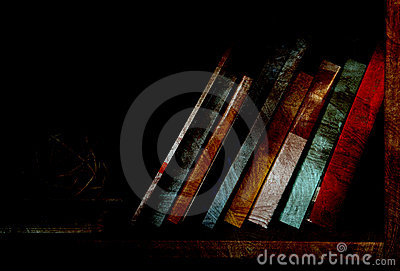 Books on dimly lit bookshelf