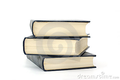 Books with flavescent pages isolated on white.