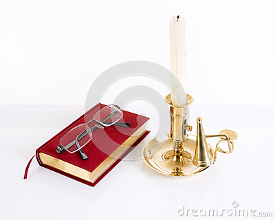 Books and glasses with candle