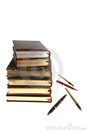Books with gold and pens