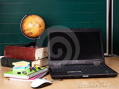Books and laptop. School supplies.