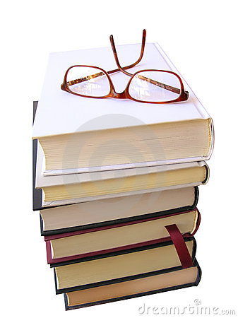 Books pile with glasses on top