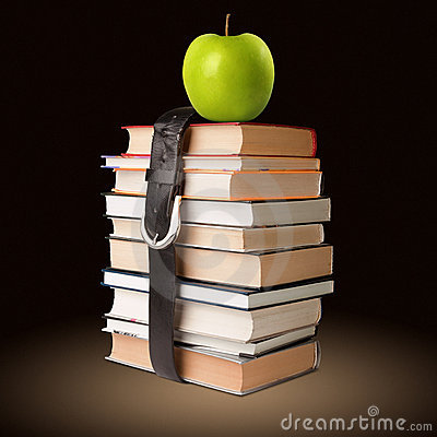 Free Books Pile With Belt And Apple Royalty Free Stock Photos - 20736598