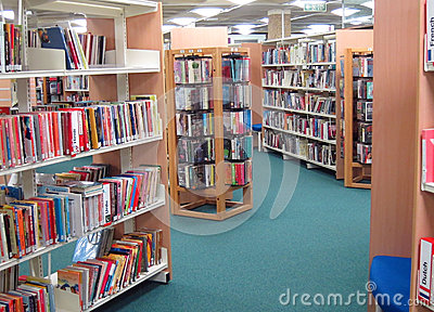 Books on a public library shelves. Editorial Stock Image