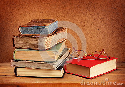 Books stack and glasses