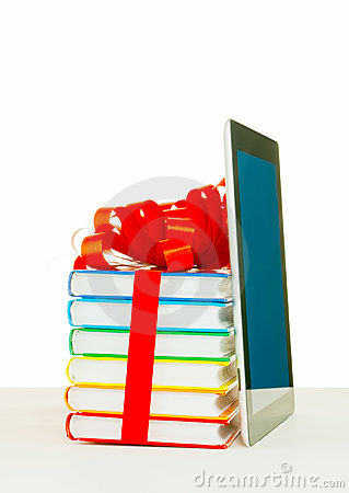Books tied up with ribbon and tablet PC