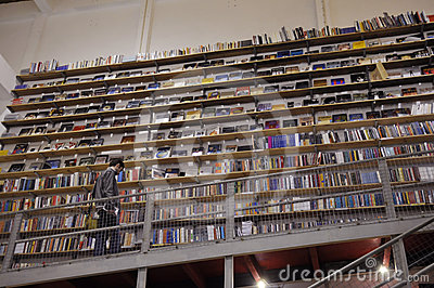 Bookstore - High Shelves with Books - Young Man Editorial Image