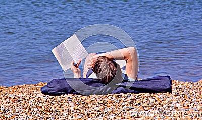 Bookworm on the beach