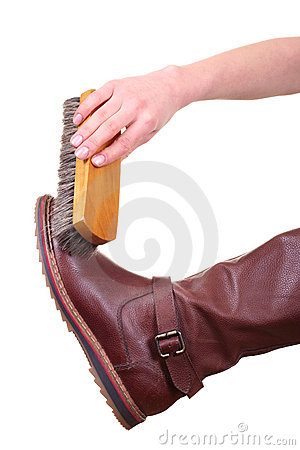 Boot cleaning with brush