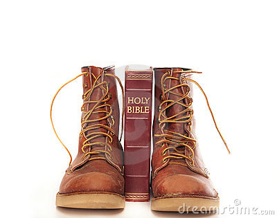 Boots and bible isolated against white