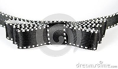 Borda para o cabelo com nó-borboleta preta