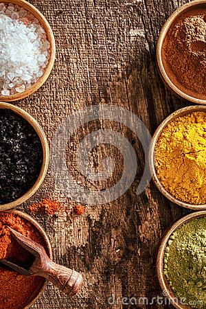 Border of colourful spice in bowls