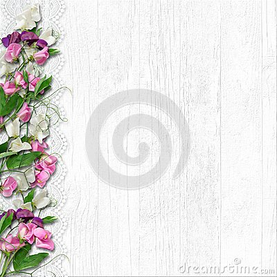 Free Border Of Beautiful Spring Flowers On A White Wooden Background Stock Photo - 112303270