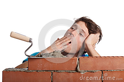 Bored bricklayer yawning