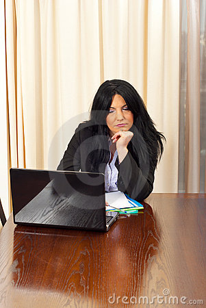Bored business woman browse on laptop