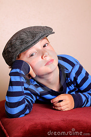 Bored Child Wearing Flat Cap