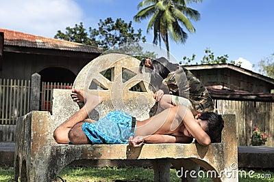 Bored Filipinos taking nap
