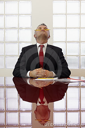 Free Bored Man Playing With Pencil At Work Royalty Free Stock Photos - 18638728