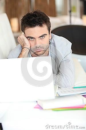 Bored man using laptop