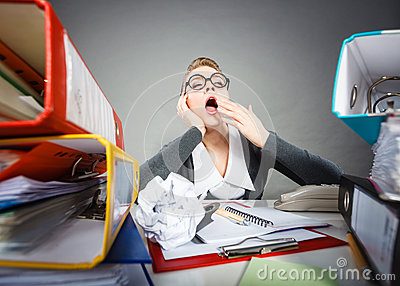Bored office employee at work. Stock Photo