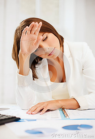 Bored and tired woman with documents
