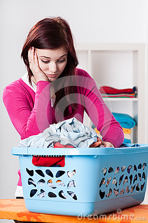 Bored woman and box with laundry