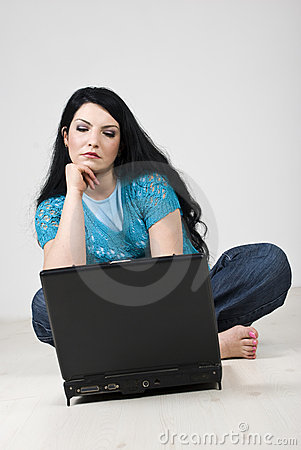 Bored woman browsing  on a laptop