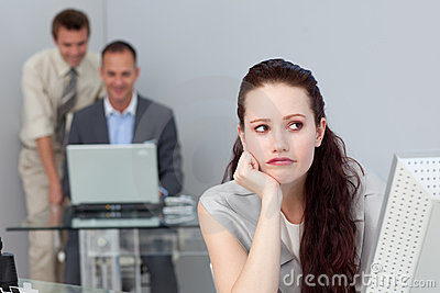 Bored woman sitting in front of her computer