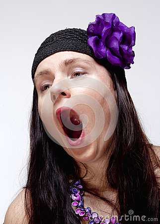 Bored Young Woman Yawning with Open Mouth