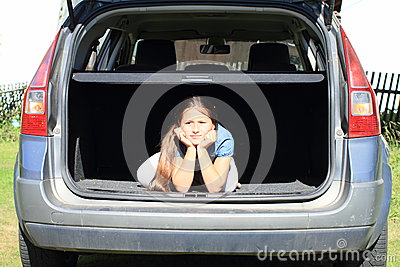 Boring girl in car trunk
