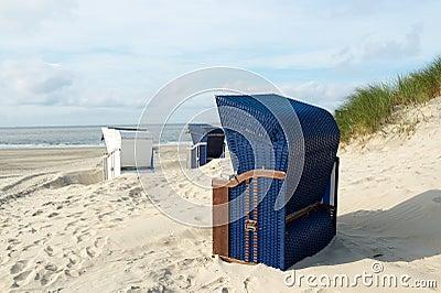 Borkum beach with blue and white chairs