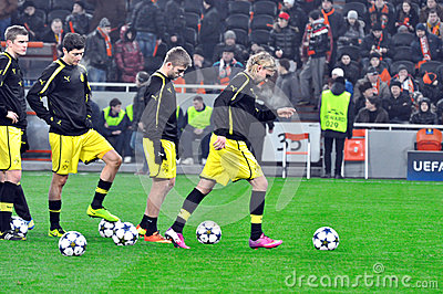 Borussia Dortmund football team with the balls on the field Editorial Photo