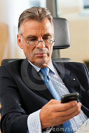 Boss in his office checking emails