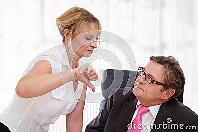 Boss and his secretary at desk