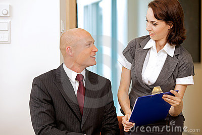 Boss and his secretary looking on documents