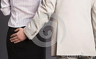 Boss hugs his subordinate