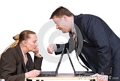 Boss instructing co-worker