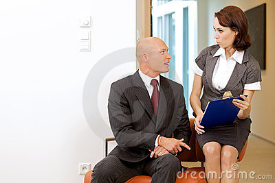 Boss and looking on documents