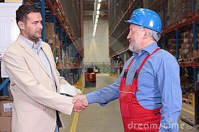 boss + older worker handshake