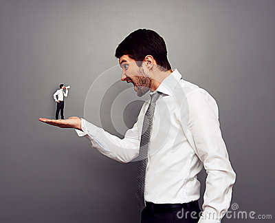 Boss screaming at the small man with megaphone