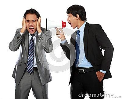 Boss shouting over his employee s ear