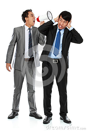 Boss shouting over his employee s ear