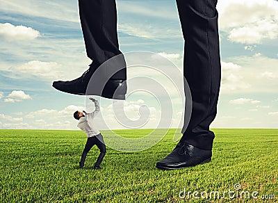Boss trampling down his subordinate