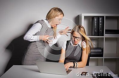 Boss yelling at her employee Stock Photo