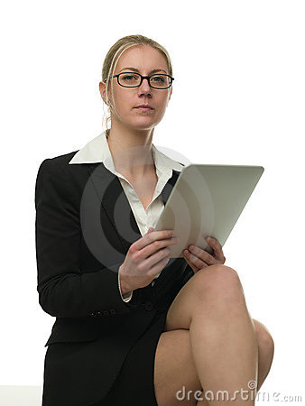 Bossy woman checking reports on a tablet comput
