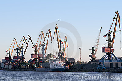 Bot and cranes in the seaport