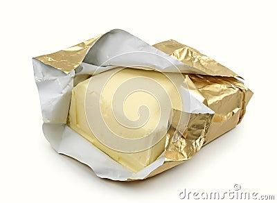 Boter in gouden folie