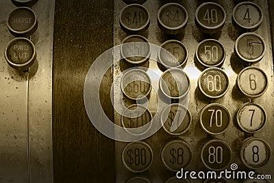 Botones antiguos monocromáticos de la caja registradora